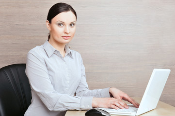 Portrait of a beautiful young businesswoman on the computer.