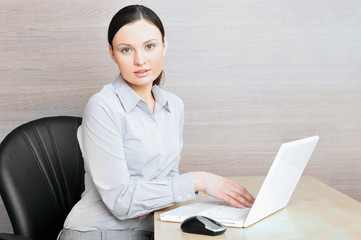 Portrait of a beautiful young businesswoman on the computer view