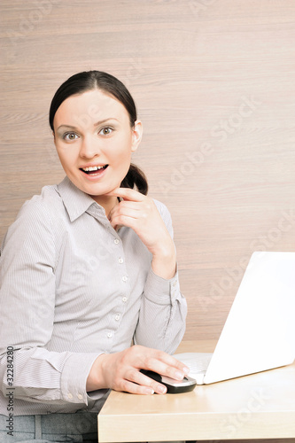Portrait of a beautiful young businesswoman on the computer, sho