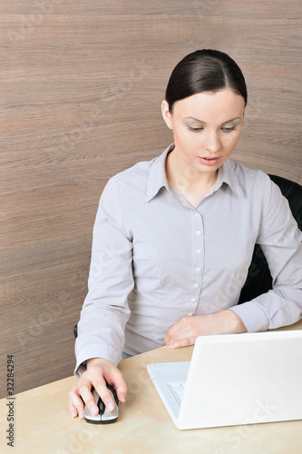 Portrait of a beautiful young businesswoman on the compuer, look