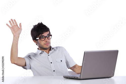 Young man with fear of his laptop