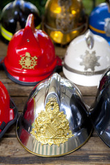 Several fireman helmets in row