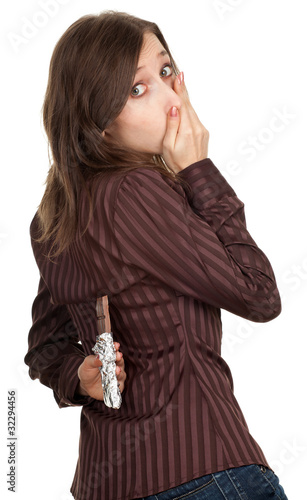 portrait of frightened young woman holding chocolate