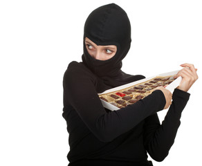 female thief with in black balacalava box of chocolates