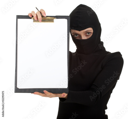 young female thief in balaclava keeping blank clipboard