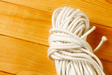 Twine on the wooden background poster