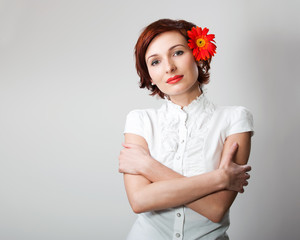 Beautiful woman with flower gerbera against white background