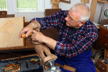 Woodcarver work in his workshop