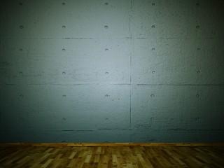 graue Betonwand mit Parkettboden