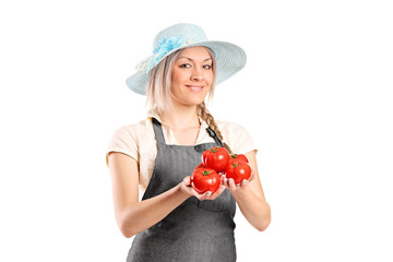 Female famer holding tomatoes