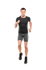 Full length portrait of a male athlete running