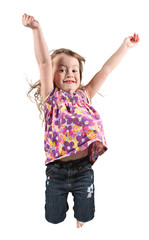 Adorable and happy little girl jumping in air.