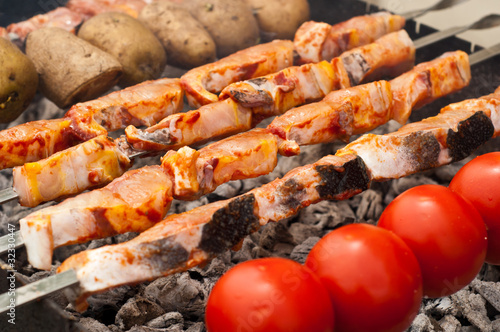 Sturgeon fillets on a skewer grilled