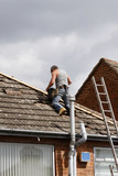 Workman repairing a roof poster