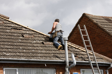 Workman repairing a roof