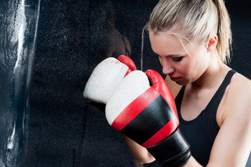 Boxing training woman with punching bag in gym