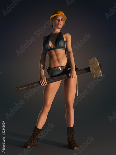 woman industrial worker holding sledgehammer