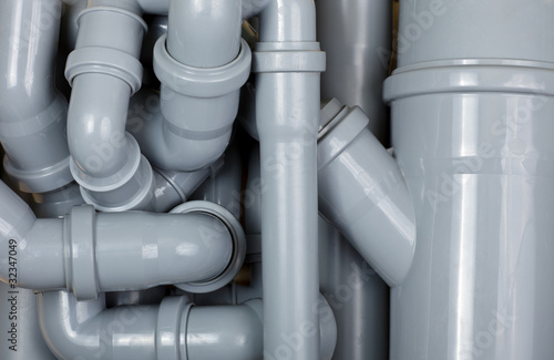 Grey PVC sewer pipes background - 32347049