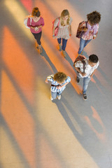 Students walking together in school corridor