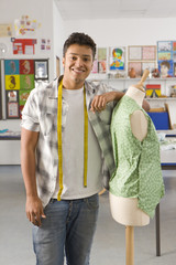 Smiling student sewing clothing in home economics classroom