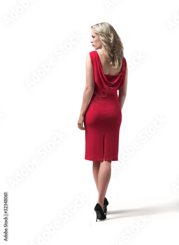 Beautiful and sexy woman in red dress, white background