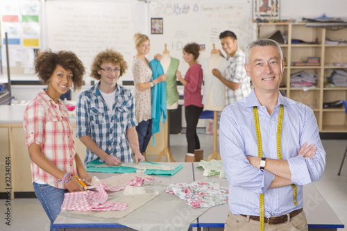 Smiling teacher and students in home economics class