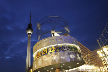 World clock with the TV tower by night