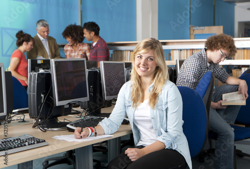 Smiling student studying in computer lab