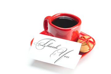 cup with coffee ,thank you card,cake nut and ribbon isolated on