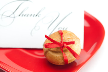 thank you card,cake nut and ribbon isolated on white