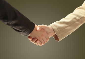 businessman's hand shaking white businessman's hand