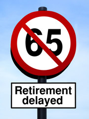 65 retirement warning roadsign against a blue sky