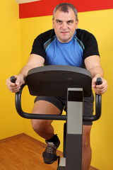 weight loss in the fitness center on the exercise bike