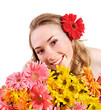 Happy young woman holding flowers.