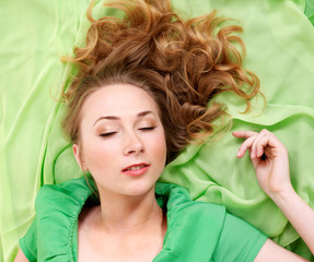 Sleeping  woman in green dress.