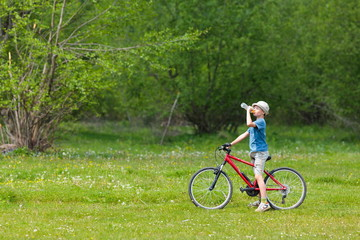 Boy with hat riding a bicycle