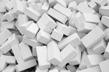 A large pile of white bricks