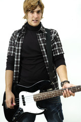 Young man posing with electric bass