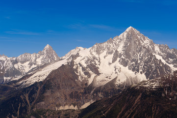 Snowbound mountain peaks. French Alps over Chamonix valley