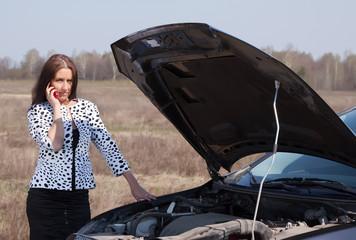 woman calling by mobile near   broken car