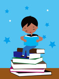 The little boy sitting on books of reading