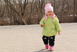 little girl walks