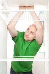 Hungry man in fridge