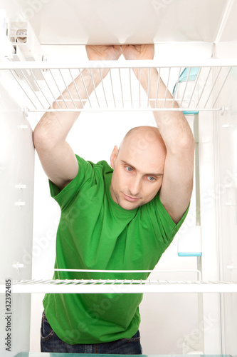 Hungry man in fridge