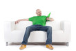 Man on sofa holding beer
