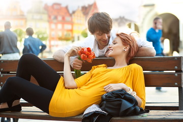 Romantic young couple relaxing outdoors smiling