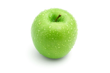 Fresh green apple with drops isolated on white background
