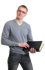 Young student in glasses with a book in their hands