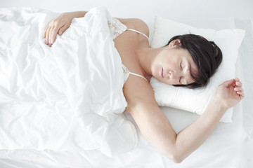 Amazing beautiful woman sleeping in her bed