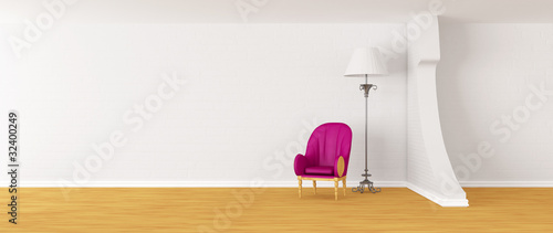 Purple armchair with standard lamp in modern interior